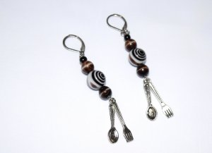 Handmade brown and black earrings with spoon and fork charms