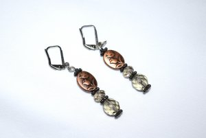 Copper flower earrings with antiqued copper flower beads accented by Czech crystals and gunmetal flower roindelles