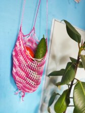Crochet hanging pouches for fruits and vegetables.