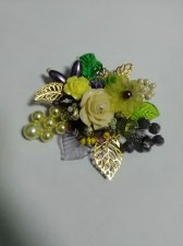 Handmade brooch with flowers and beads. Unique design is a great gift.