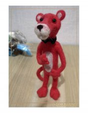 pink panther. A toy. Felting from wool
