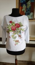 A blouse is embroidered the Summer flowers